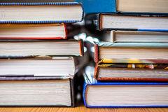 books-pile-hardback-wooden-table-40463959